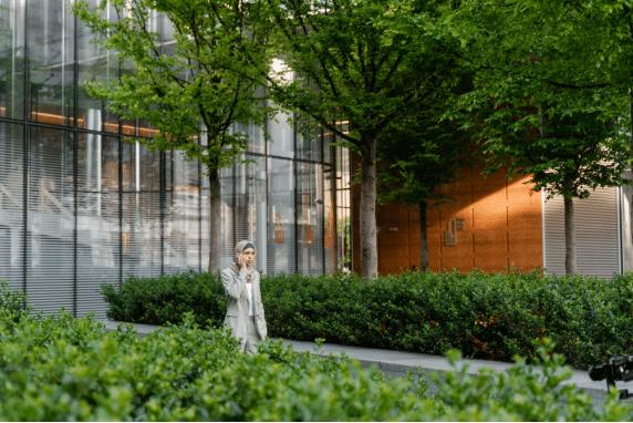 Woman walking near a building
